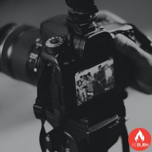 image illustrates a camera taking photos or videos as content creation is a service provided by reburn marketing