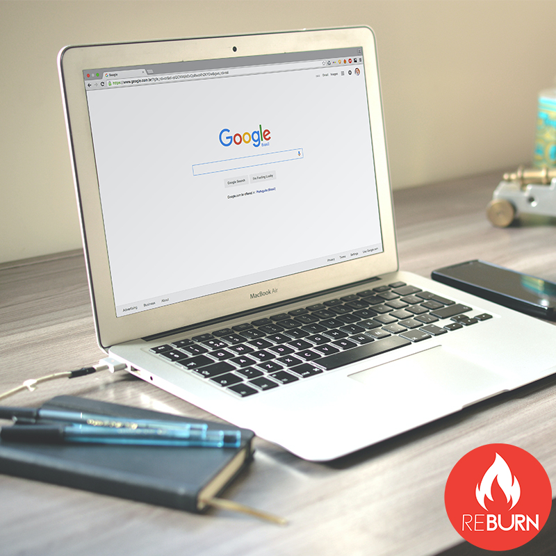 a laptop on a desk with a marketing graphic on the screen as reburn marketing provides digital marketing